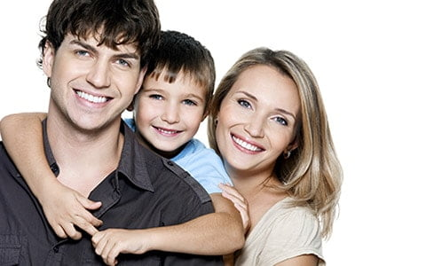 Family of 3 hugging and smiling - family dentistry - dentist centennial co