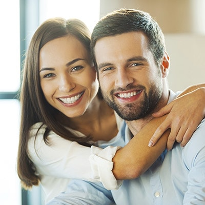 Dentist Highlands Ranch - couple hugging and smiling