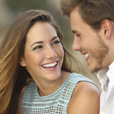 Dentist Highlands Ranch - couple looking at each other smiling