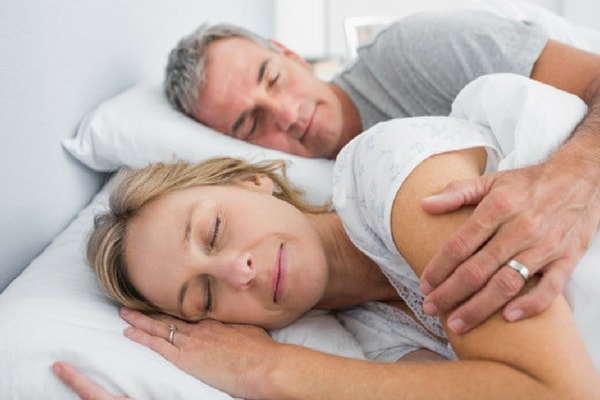 Older couple sleeping peacefully after receiving treatment for sleep apnea in Centennial, CO