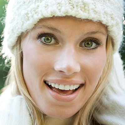 Dentist Highlands Ranch - woman in white hat smiling